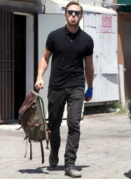 ryan-gosling-black-polo